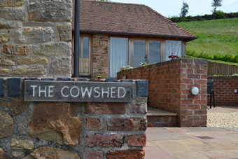 The entrance to <br>The Cowshed